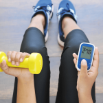 A Woman Checking Diabetes Level while doing Exercise